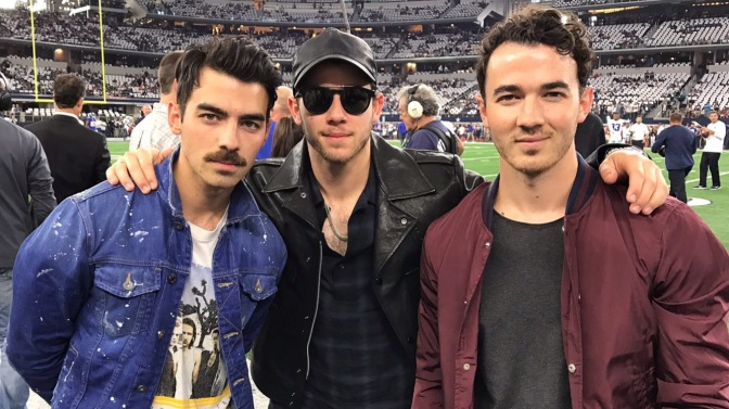 Joe Jonas, Nick Jonas and Kevin Jonas Attend Dallas Cowboys Game