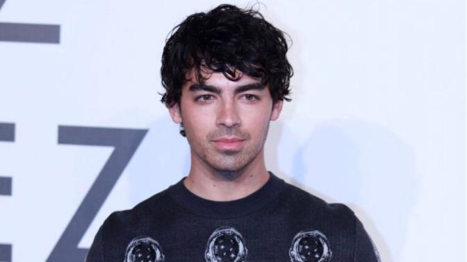 Joe Jonas Attends Louis Vuitton Exhibit in Shanghai